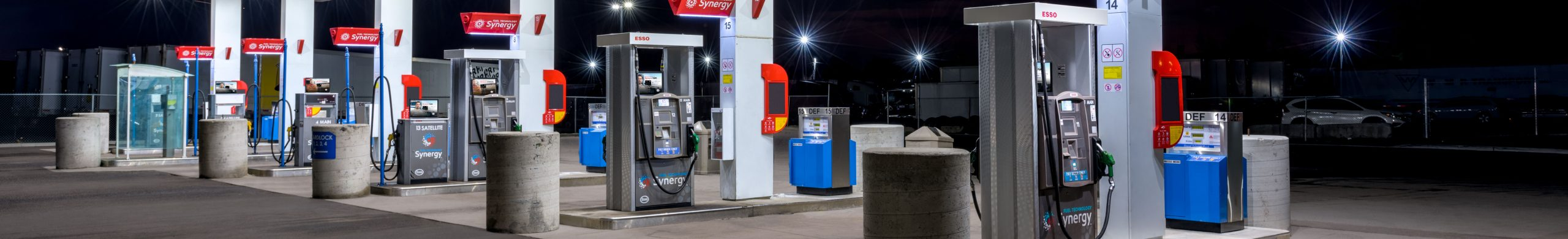 Photo of fuel dispensers beneath an Esso cardlock canopy at night